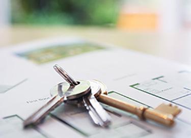 keys on top of paperwork
