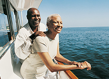 elderly man and woman smiling on boat